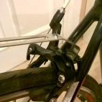 Attaching rear rack to brake bolt with the metal frame